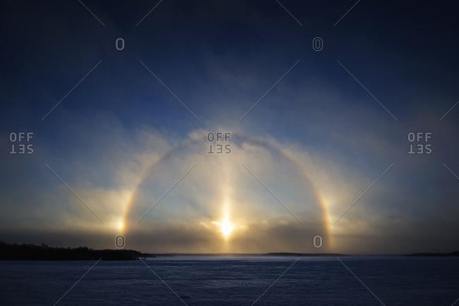 Three sundogs and a halo of light
