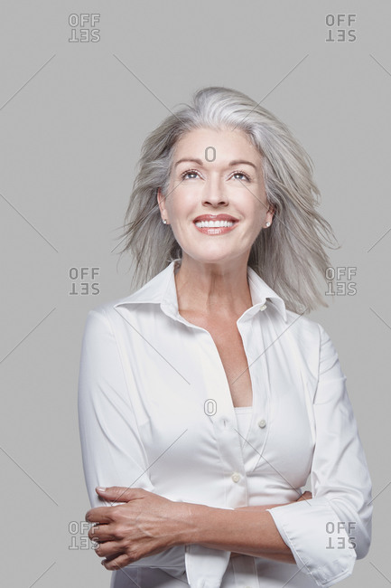 Studio portrait of a woman with grey hair