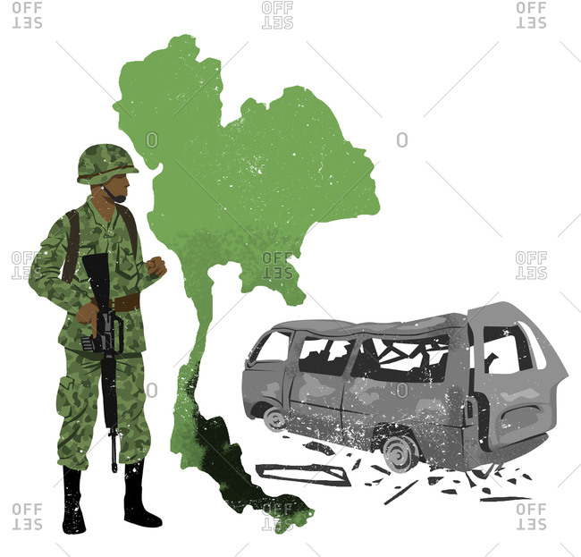 Solider standing next to a ruined van