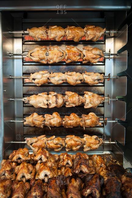 Rotisserie chickens roasting