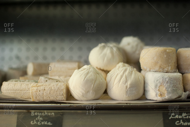 Selection of cheese on store shelf