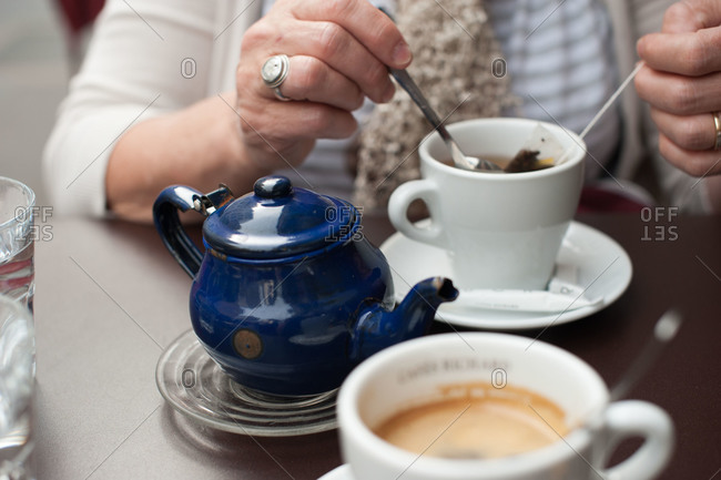 Woman with cup of tea at cafe