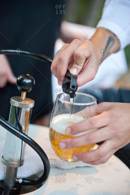A man pouring beer from a tap