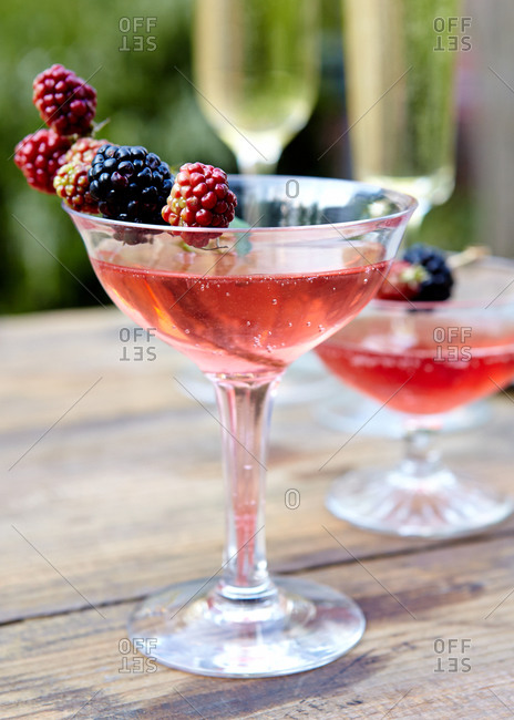 Fizzy cocktail garnished with blackberries