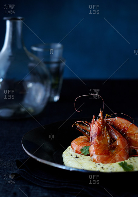 Shrimp and grits served on a table