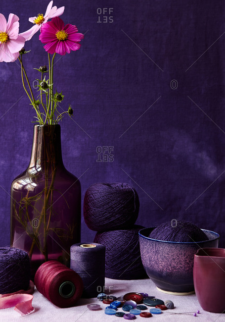 Still life of vase and yarns with buttons