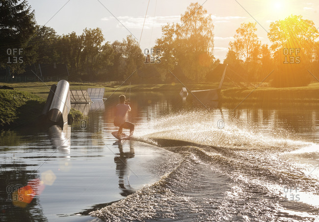 Young man wakeboarding