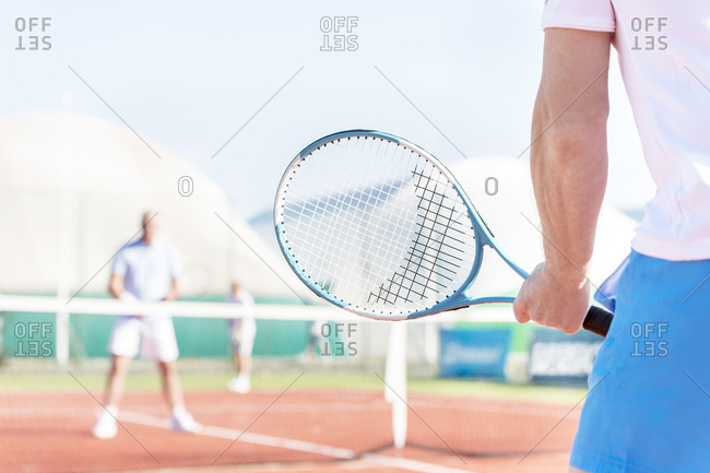 Tennis player holding tennis racket