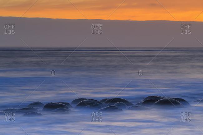 USA, California, Mendocino County, Schooner Gulch State Beach, Bowling Ball Beach at sunset