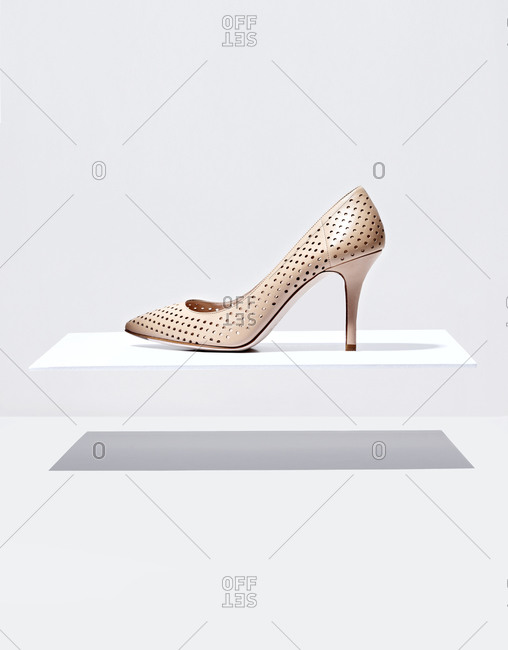 Woman's high heel on white block