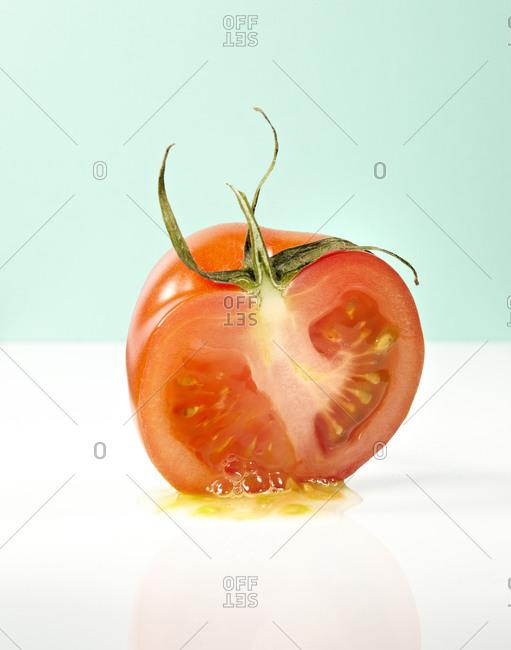 Half of juicy ripe tomato