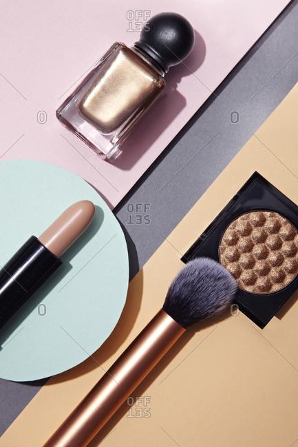 Lipstick, powder and nail polish makeup
