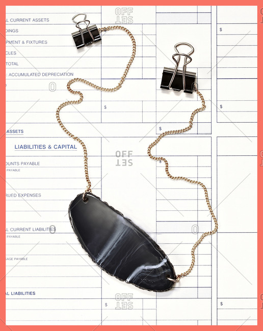 Necklace on accounting sheet