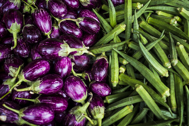 Fresh eggplants and okra on display in Little India market