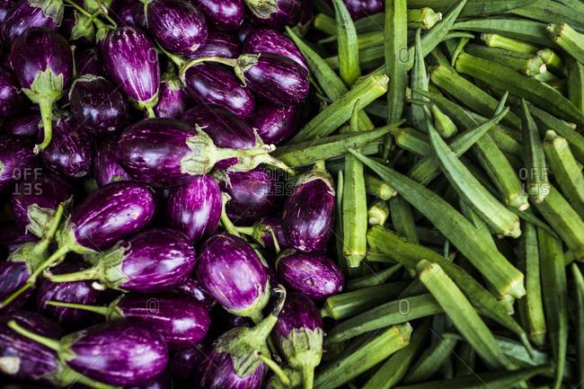 Fresh eggplants and okra on display in Little India market