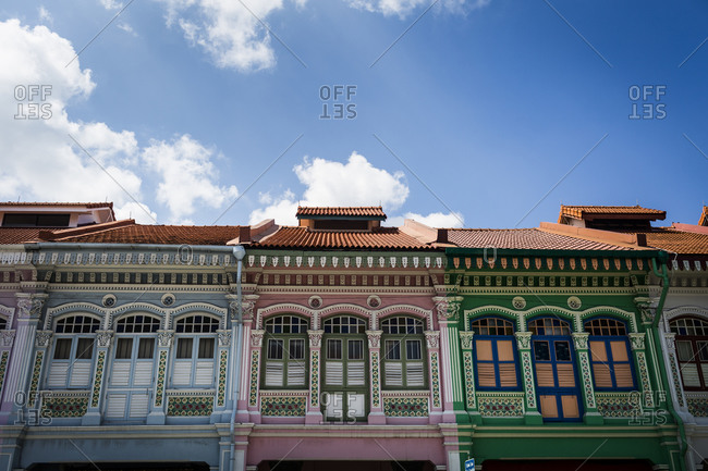 Singapore - February 17, 2015: Terra cotta rooflines of shophouses in Singapore