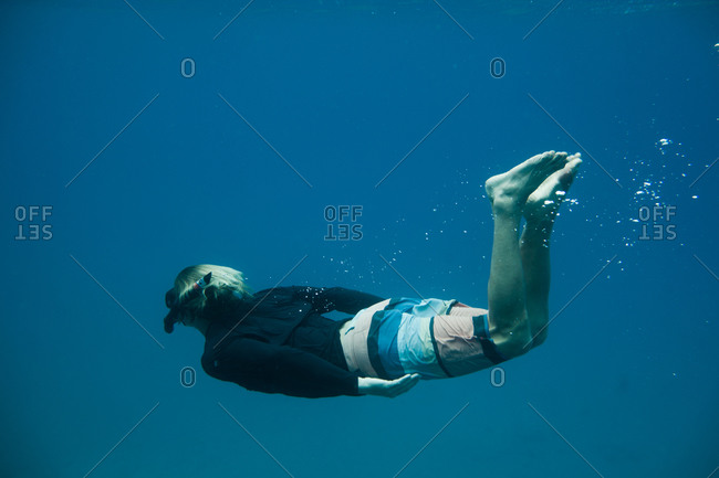 Man snorkeling in the Pacific Ocean