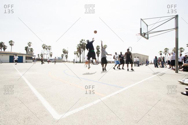 Venice beach, California, USA - April 3, 2010: People playing basketball at Venice beach