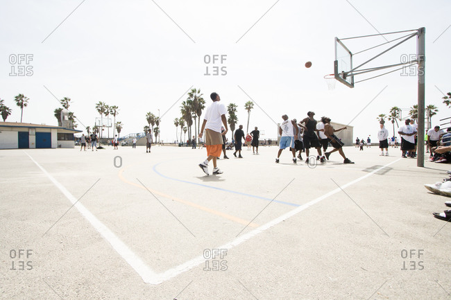 Venice beach, California, USA - April 3, 2010: Men playing basketball at Venice beach