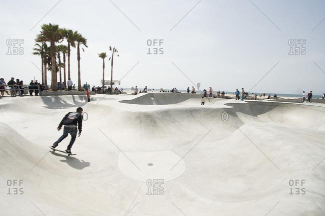 Venice beach, California, USA - April 3, 2010: Man skateboarding in Venice beach