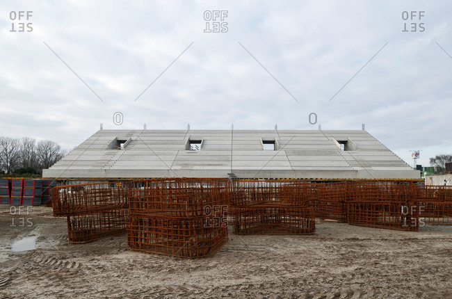 Front view of stadium seating with steel cages on ground