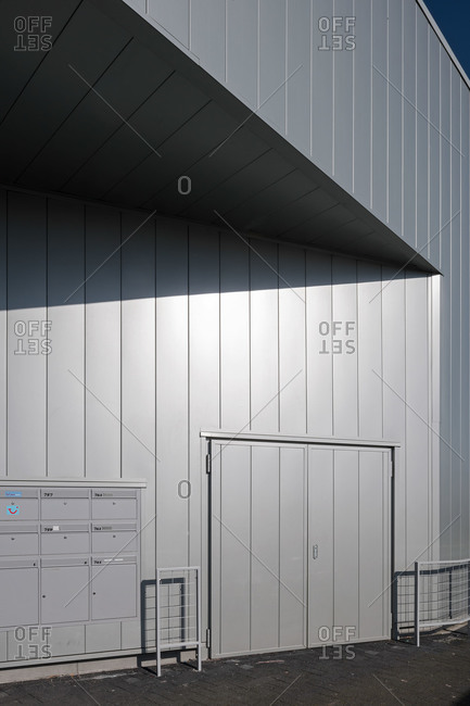 Exterior doorway and mailboxes of a large warehouse building