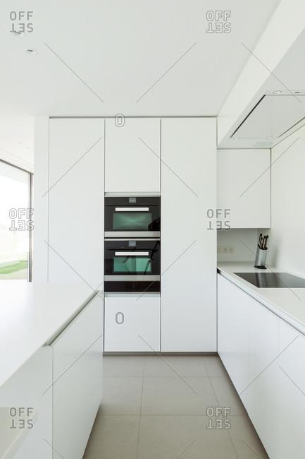Streamlined white modern kitchen