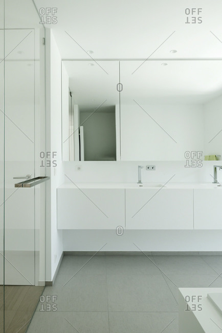 View of sink area of a modern white bathroom