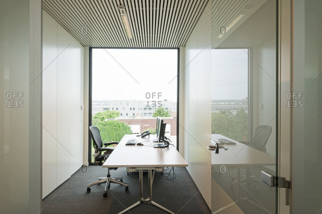 Private office with window in a modern building