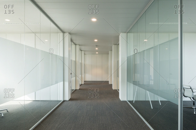 Glass-walled offices and meeting areas in a corporate building
