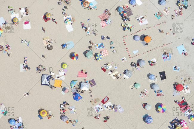 Aerial View Of People Sunbathing On The Beach In Coney Island Brooklyn NYC