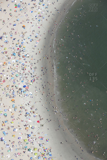 Crowded beach on a summer day in Coney Island, Brooklyn, NYC
