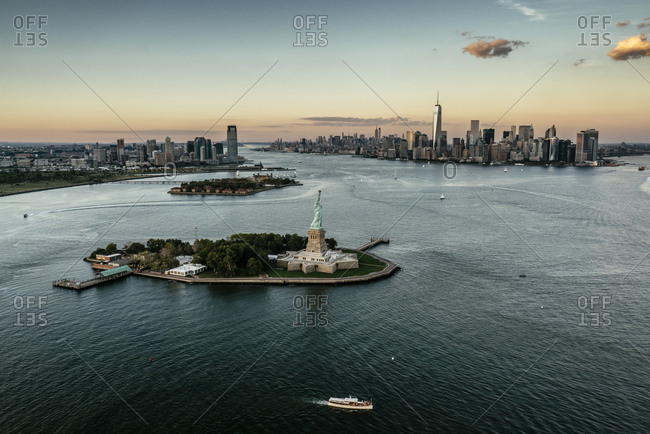 Liberty Island with the Statue of Liberty at dusk, NYC