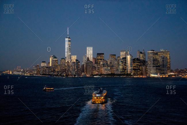 Ferry sailing towards Manhattan in New York City, USA