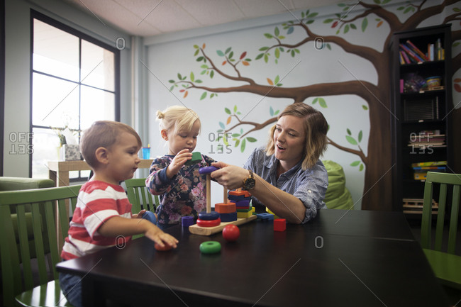Woman and children playing with blocks