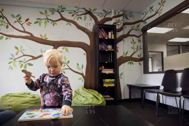 Young girl fitting puzzle pieces