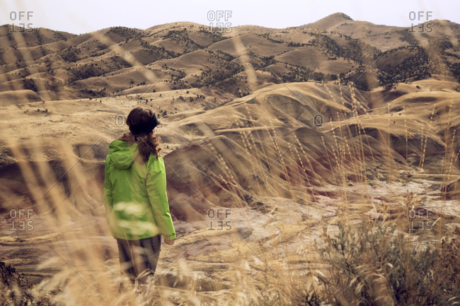 Woman overlooking badlands of John Day Fossil Bed
