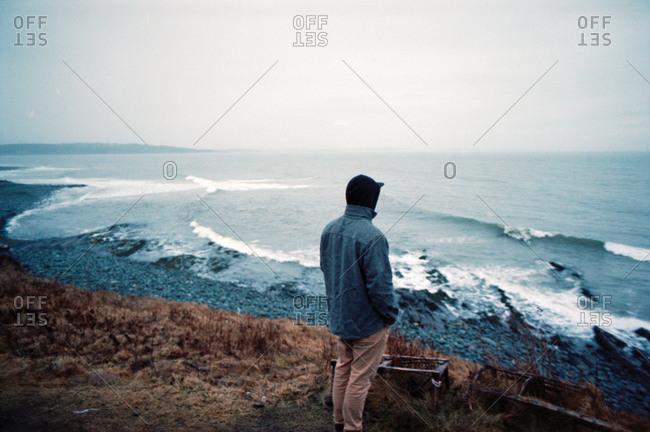 Man standing on rugged Nova Scotia coast