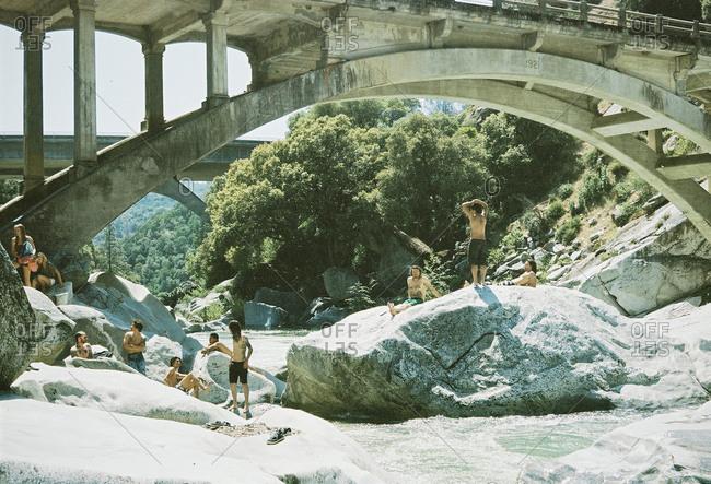 Grass Valley, California - January 12, 2013: Friends under bridge in wilderness
