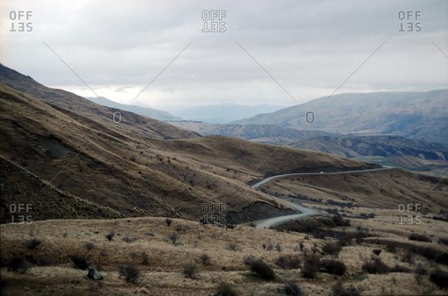 Road running through remote New Zealand hills