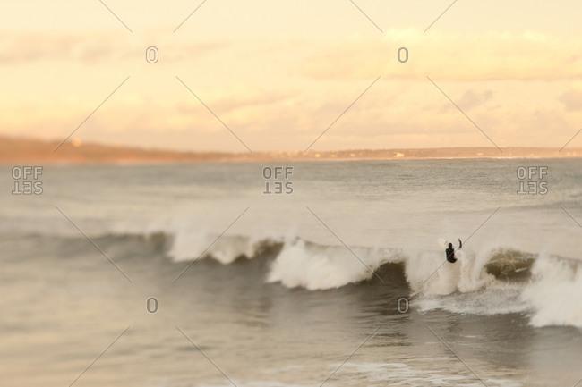 Surfer hitting wave in Nova Scotia