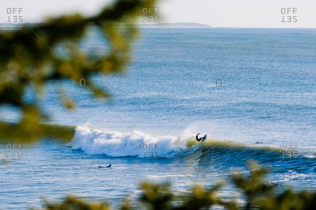 Surfers riding wave in Nova Scotia
