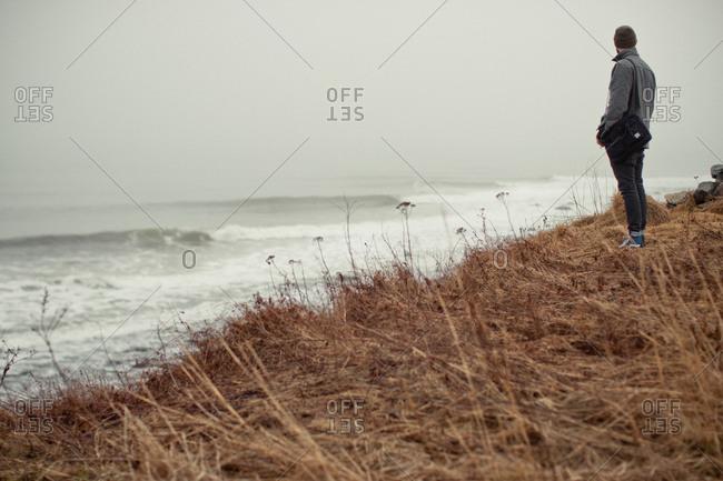 Man on rugged Nova Scotia coastline