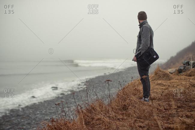 Man standing on rugged Nova Scotia coastline