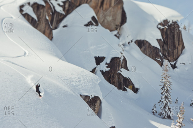 Man snowing down snowy cliffs in Lake Tahoe