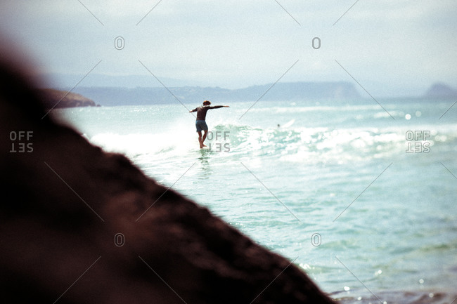 Man balancing on surfboard in Spain