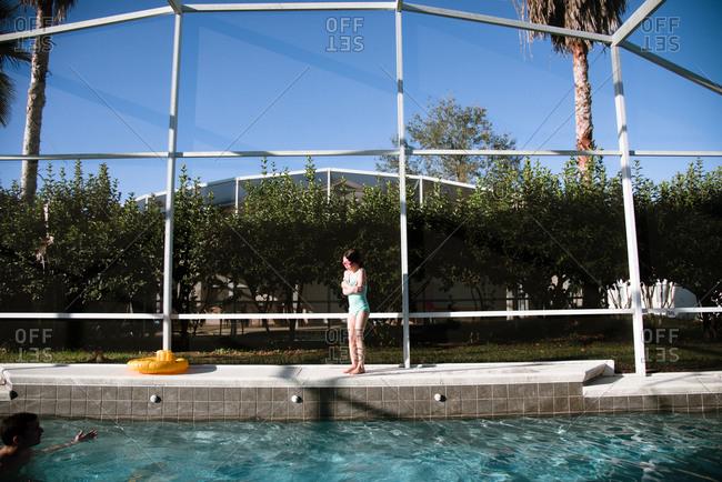 Girl afraid at pool's edge