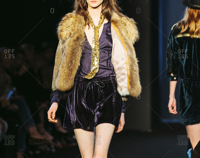 Paris, France - March 5, 2013: Model wearing fox fur coat on catwalk at the Zadig and Voltaire fashion show