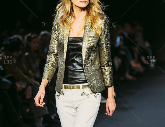 Paris, France - March 5, 2013: Model wearing golden jacquard jacket at the Zadig and Voltaire fashion show