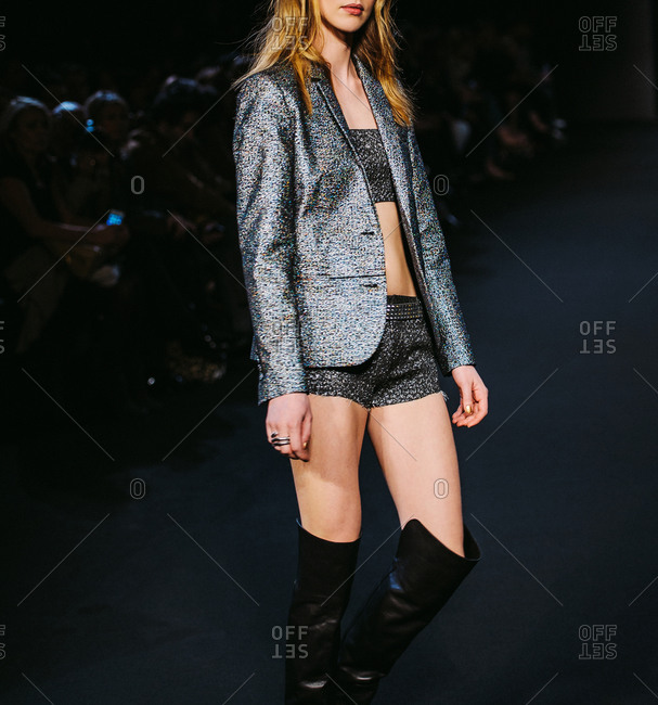 Paris, France - March 5, 2013: Model posing with silver glitter jacket at the Zadig and Voltaire fashion show